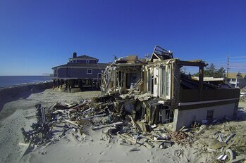 Damaged homes along the beach in Mantoloking, N.J.