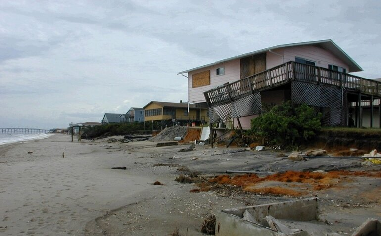Homes along the beach in Oak Island, N.C., were damaged by hurricane-force winds
