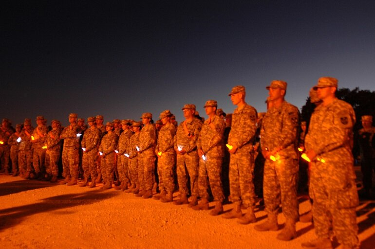 Soldiers at a chemical light vigil at Fort Hood in 2009