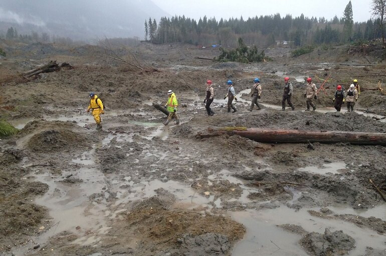 Responders search the site of the Oso mudslide
