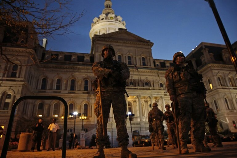 Members of the National Guard stand guard at Baltimore City Hall