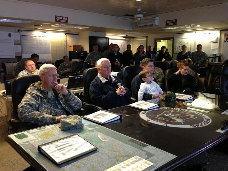 Pennsylvania Gov. Tom Corbett and Lt. Gov. Jim Cawley are briefed on Sandy