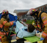 Firefighters decontaminate victims of a simulated bioterrorism attack
