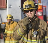 Firefighter talking on a radio