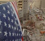 American flag hangs above the wreckage at the World Trade Center 