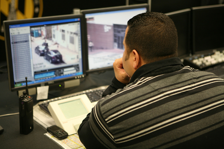 A Baltimore police officer monitors security cameras that are installed throughout the city.